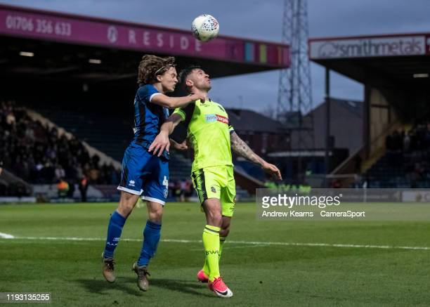 Bolton Wanderers' Daryl Murphy competing with Rochdale's Luke Matheson during the Sky Bet League One match between Rochdale and Bolton Wanderers at...