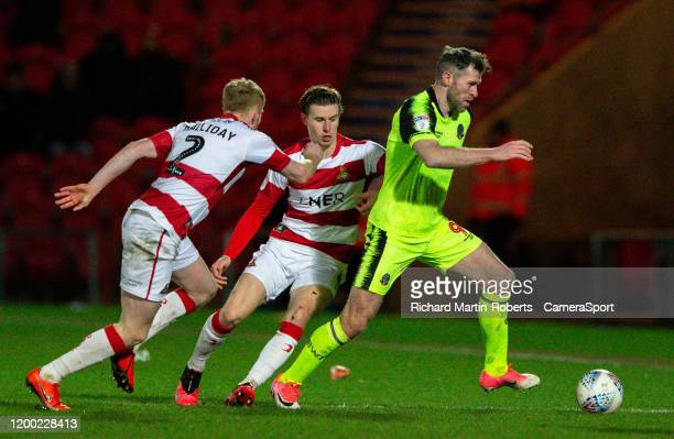 Bolton Wanderers' Daryl Murphy gets away from Doncaster Rovers' Brad Halliday and Ben Sheaf during the Sky Bet Championship match between Brentford...
