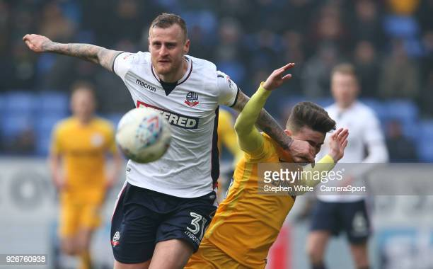 Bolton Wanderers' David Wheater battles with Preston North End's Sean Maguire during the Sky Bet Championship match between Bolton Wanderers and...