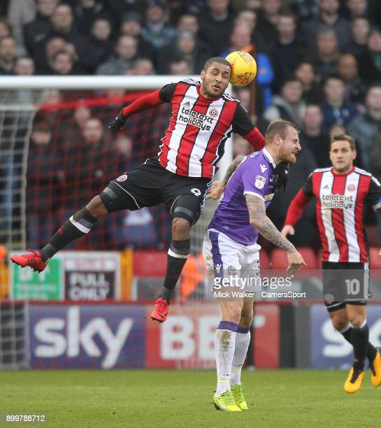 Bolton Wanderers David Wheater battles with Sheffield United's Leon Clarke during the Sky Bet Championship match between Sheffield United and Bolton...