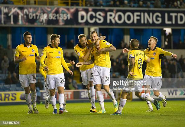 Bolton Wanderers' David Wheater celebrates scoring his sides second goal during the Sky Bet League One match between Millwall and Bolton Wanderers at...