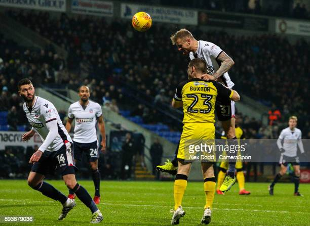 Bolton Wanderers' David Wheater heads at goal over Burton Albion's Jake Buxton during the Sky Bet Championship match between Bolton Wanderers and...