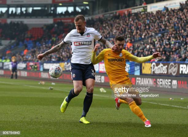 Bolton Wanderers' David Wheater shields the ball from Preston North End's Billy Bodin during the Sky Bet Championship match between Bolton Wanderers...