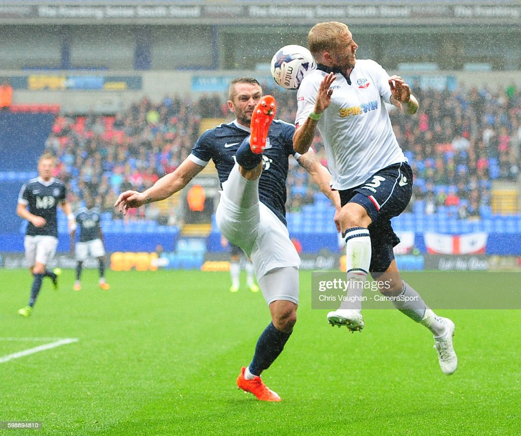 Bolton Wanderers' Dean Moxey vies for possession with Southend United's John White during the Sky Bet League One match between Bolton Wanderers and Southend United at Macron Stadium on September 3, 2016 in Bolton, England.