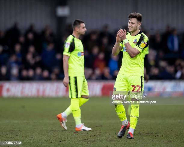 Bolton Wanderers' Dennis Politic applauds his side's travelling supporters at the end of the match during the Sky Bet Leauge One match between AFC...