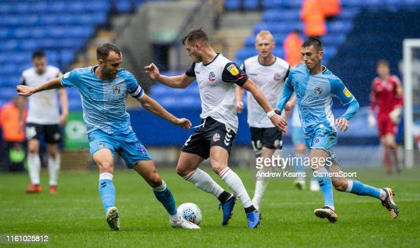 Bolton Wanderers' Dennis Politic challenges Coventry City's Liam Kelly as team mate Kyle McFadzean looks on during the Sky Bet League One match...