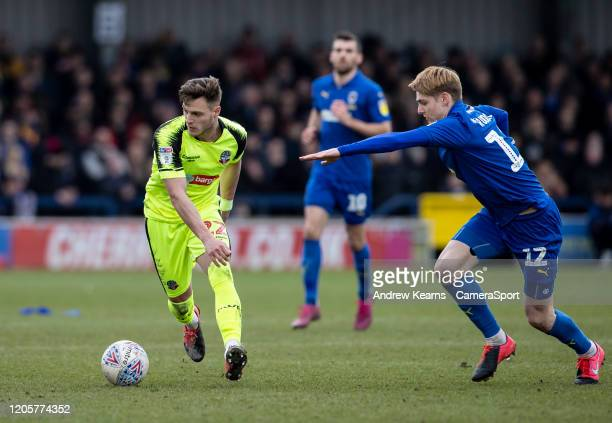 Bolton Wanderers' Dennis Politic competing with AFC Wimbledon's Jack Rudoni during the Sky Bet Leauge One match between AFC Wimbledon and Bolton...