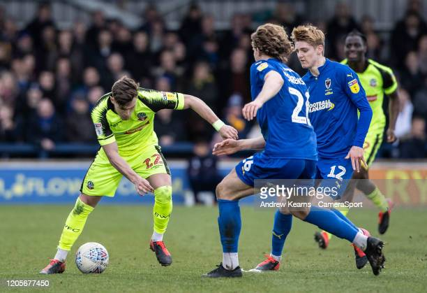 Bolton Wanderers' Dennis Politic competing with AFC Wimbledon's Mads Bech Sorensen and Jack Rudoni during the Sky Bet Leauge One match between AFC...