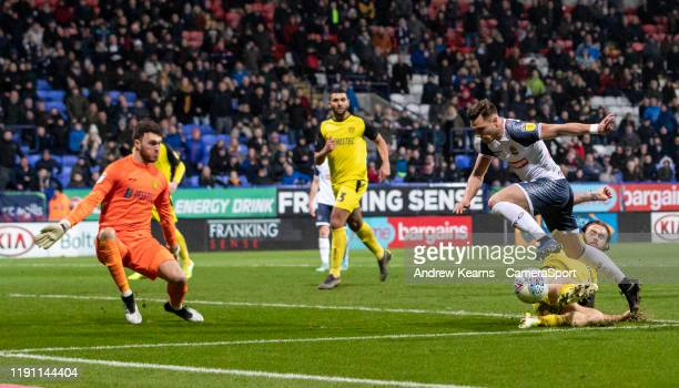Bolton Wanderers' Dennis Politic is tackled by Burton Albion's John Brayford during the Sky Bet League One match between Bolton Wanderers and Burton...