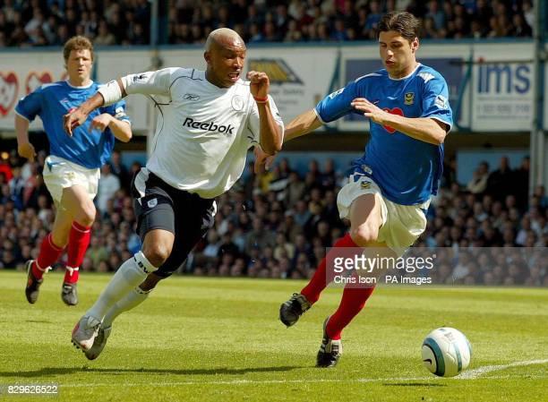 Bolton Wanderers' El-Hadji Diouf passes Portsmouth's Dejan Stefanovic to score.