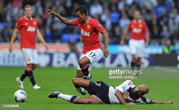 Bolton Wanderers' English midfielder Darren Pratley vies with Manchester United's Portuguese midfielder Nani during the English Premier League...