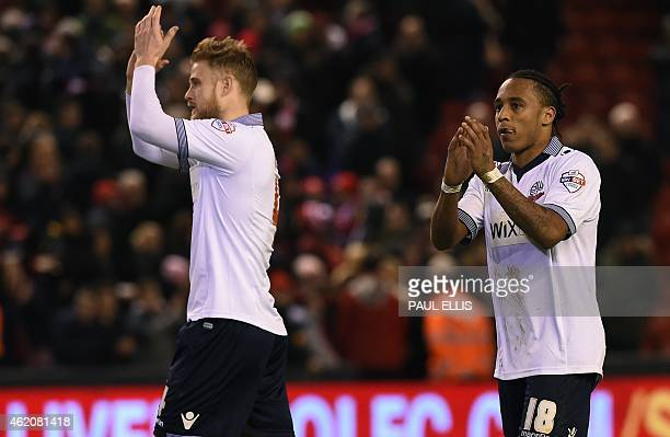 Bolton Wanderers' English midfielder Neil Danns and Bolton Wanderers' English defender Matt Mills applaud their supporters as they leave the pitch...