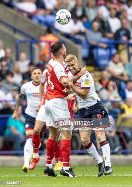 Bolton Wanderers' Eoin Doyle competing with Rotherham United's Richard Wood during the Sky Bet League One match between Bolton Wanderers and...