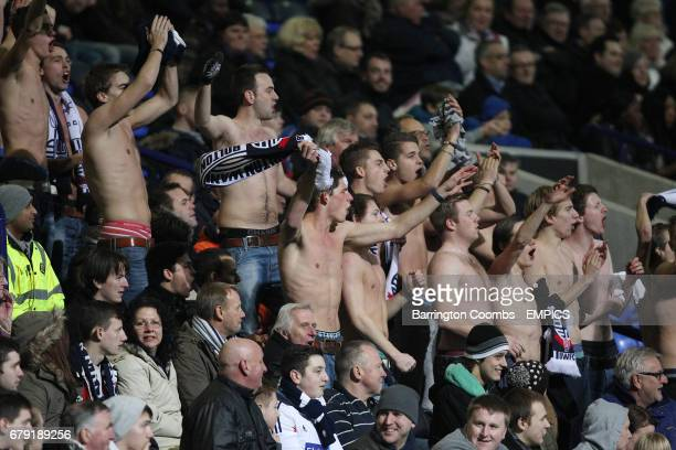 Bolton Wanderers' fans go bare chested during the game against Blackpool