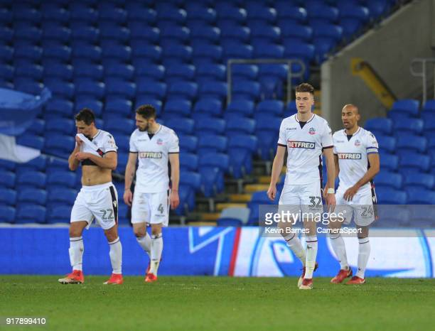 Bolton Wanderers' Filipe Morais Dorian Dervite Reece Burke and Karl Henry look dejected after Cardiff City's Sean Morrison scores his sides second...