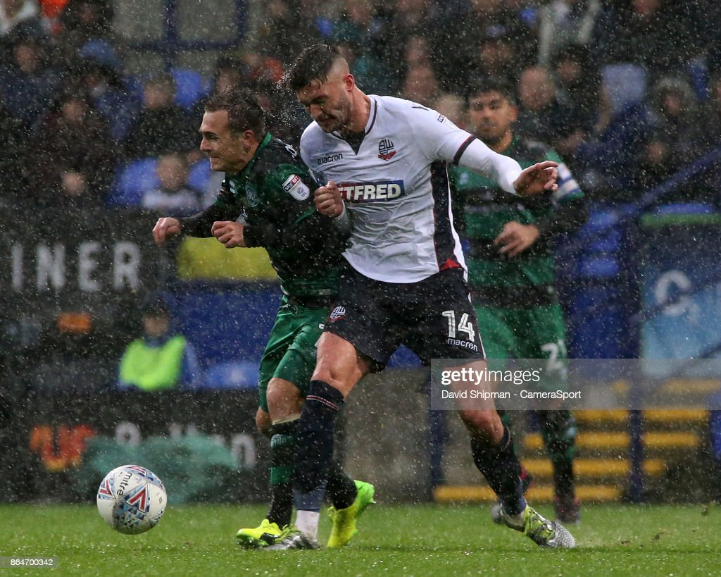 Bolton Wanderers' Gary Madine battles with Queens Park Rangers' Josh Scowen during the Sky Bet Championship match between Bolton Wanderers and Queens Park Rangers at Macron Stadium on October 21, 2017 in Bolton, England.