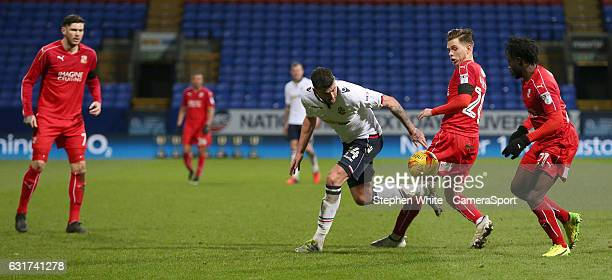 Bolton Wanderers' Gary Madine battles with Swindon Town's Charlie Colkett during the Sky Bet League One match between Bolton Wanderers and Swindon...