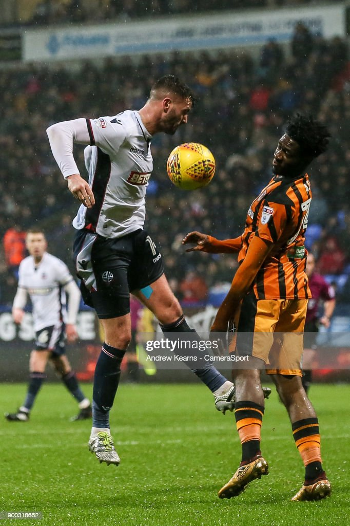 Bolton Wanderers' Gary Madine competing with Hull City's Ola Aina during the Sky Bet Championship match between Bolton Wanderers and Hull City at Macron Stadium on January 1, 2018 in Bolton, England.