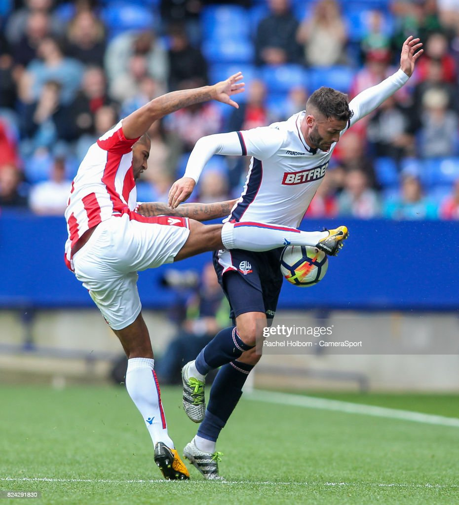 Bolton Wanderers' Gary Madine competing with Stoke City's Glen Johnson during the pre-season friendly match between Bolton Wanderers and Stoke City at Macron Stadium on July 29, 2017 in Bolton, England.
