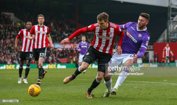 Bolton Wanderers' Gary Madine is tackled by Brentford's Andreas Bjelland during the Sky Bet Championship match between Brentford and Bolton Wanderers...