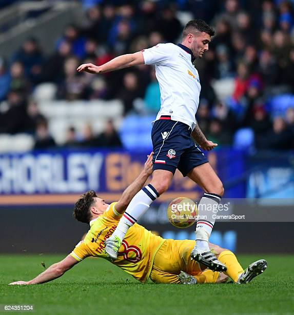 Bolton Wanderers' Gary Madine is tackled by Millwall's Ben Thompson during the Sky Bet League One match between Bolton Wanderers and Millwall at...