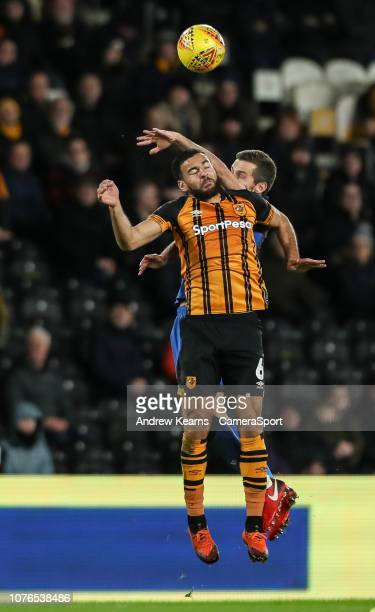 Bolton Wanderers' Gary O'Neil competing with Hull City's Kevin Stewart during the Sky Bet Championship match between Hull City and Bolton Wanderers...
