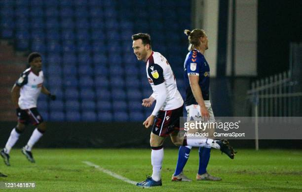 Bolton Wanderers' Gethin Jones celebrates after Oldham Athletic's Harry Clarke put into his own net during the Sky Bet League Two match between...