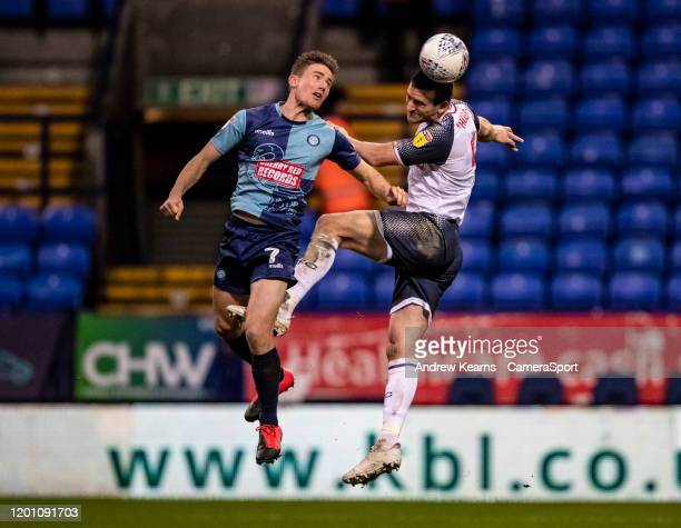 Bolton Wanderers' Jack Hobbs competing with Wycombe Wanderers' David Wheeler during the Sky Bet League One match between Bolton Wanderers and Wycombe...