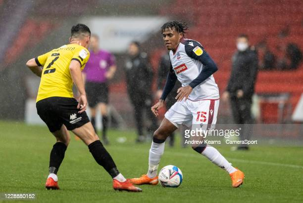 Bolton Wanderers Jamie Mascoll competing with Harrogate Towns Ryan Fallowfield during the Sky Bet League Two match between Harrogate Town and Bolton...