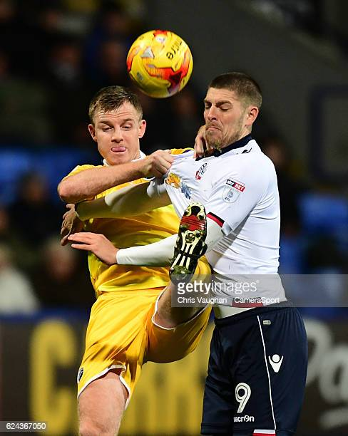 Bolton Wanderers' Jamie Proctor vies for possession with Millwall's Tony Craig during the Sky Bet League One match between Bolton Wanderers and...