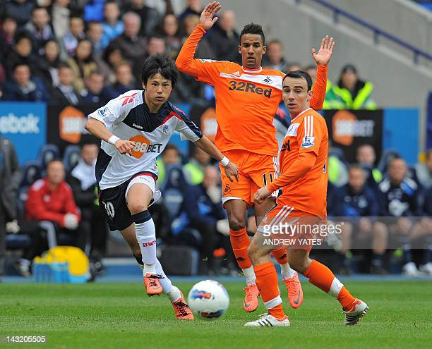 Bolton Wanderers' Japanese striker Ryo Miyaichi vies with Swansea City's English midfielders Leon Britton and Scott Sinclair during the English...