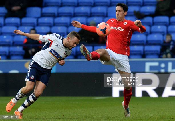Bolton Wanderers Jay Spearing battles for the ball with Cardiff City's Peter Whittingham during the FA Cup Fourth Round match at the Reebok Stadium...