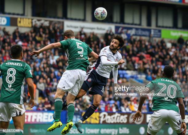 Bolton Wanderers' Jem Karacan competing in the air with Brentford's Andreas Bjelland during the Sky Bet Championship match between Bolton Wanderers...