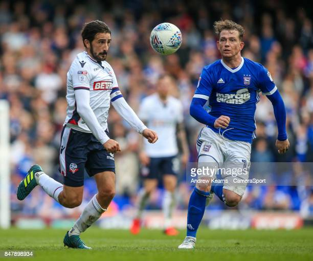 Bolton Wanderers' Jem Karacan competing with Ipswich Town's Joe Garner during the Sky Bet Championship match between Ipswich Town and Bolton...