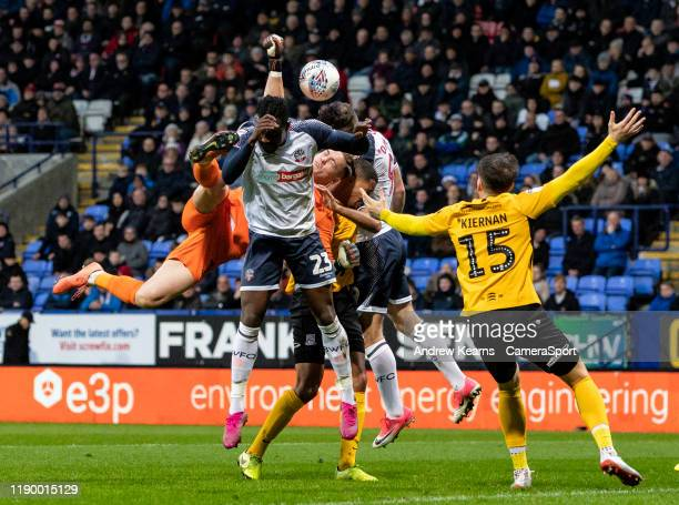Bolton Wanderers' Joe Dodoo competing with Southend United's goalkeeper Nathan Bishop during the Sky Bet League One match between Bolton Wanderers...