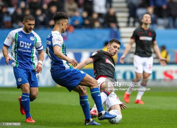 Bolton Wanderers' Joe Williams competing with Wigan Athletic's Antonee Robinson during the Sky Bet Championship match between Wigan Athletic and...