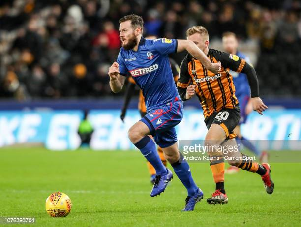 HULL ENGLAND JANUARY Bolton Wanderers' Jonathan Grounds breaks away from Hull City's Jarrod Bowen during the Sky Bet Championship match between Hull...