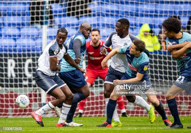 Bolton Wanderers' Josh Emmanuel competing with Wycombe Wanderers' Adebayo Akinfenwa during the Sky Bet League One match between Bolton Wanderers and...