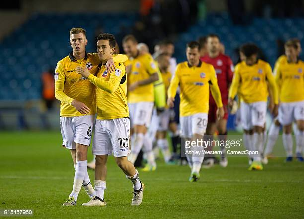 Bolton Wanderers' Josh Vela and Zach Clough at the final whistle during the Sky Bet League One match between Millwall and Bolton Wanderers at The Den...