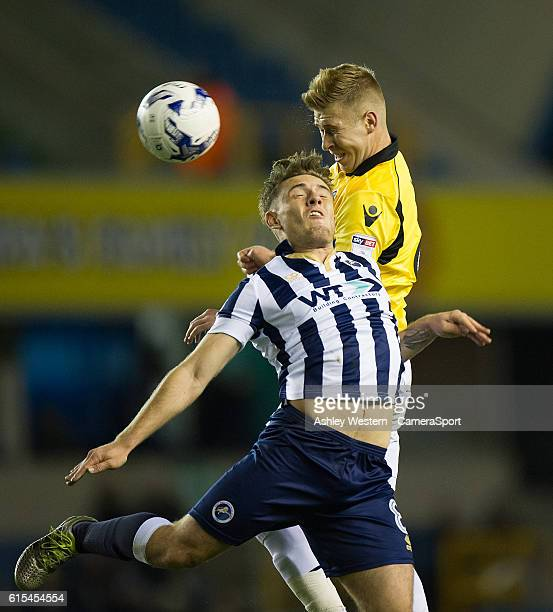 Bolton Wanderers' Josh Vela battles for possession with Millwall's Ben Thompson during the Sky Bet League One match between Millwall and Bolton...