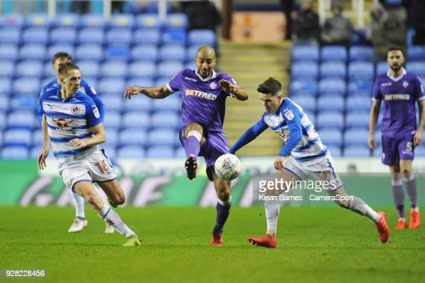 Bolton Wanderers' Karl Henry vies for possession with Reading's Liam Kelly as Dave Edwards looks on during the Sky Bet Championship match between...