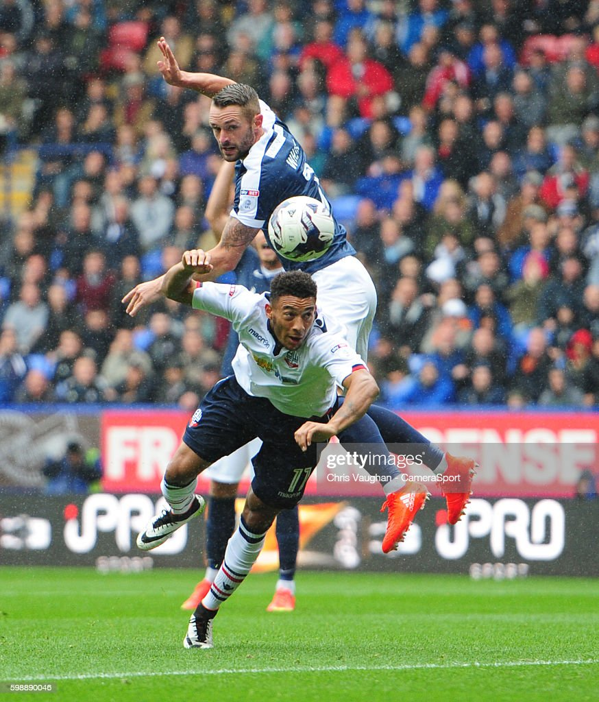 Bolton Wanderers' Keshi Anderson vies for possession with Southend United's John White during the Sky Bet League One match between Bolton Wanderers and Southend United at Macron Stadium on September 3, 2016 in Bolton, England.