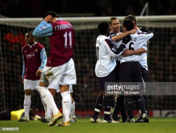 Bolton Wanderers' Kevin Davies celebrates with teammates after scoring the equaliser goal against West Ham United during the FA Cup fifth round...