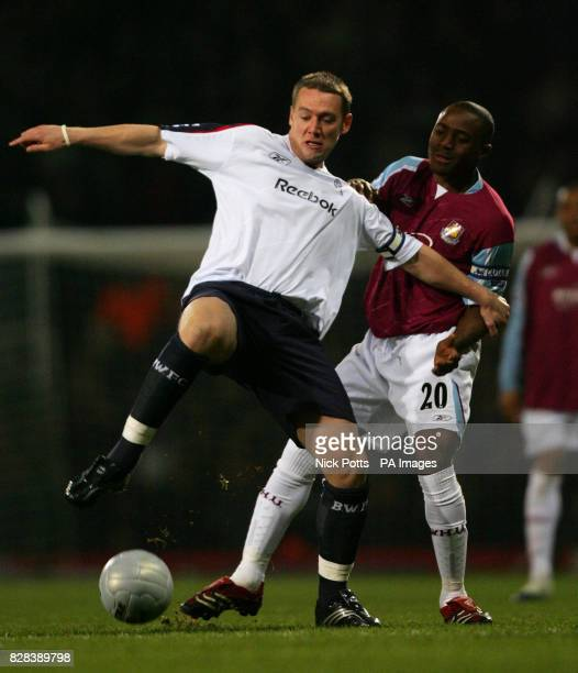 Bolton Wanderers' Kevin Nolan holds the ball away from West Ham United's Nigel Reo Coker during the FA Cup fifth round replay match at Upton Park...