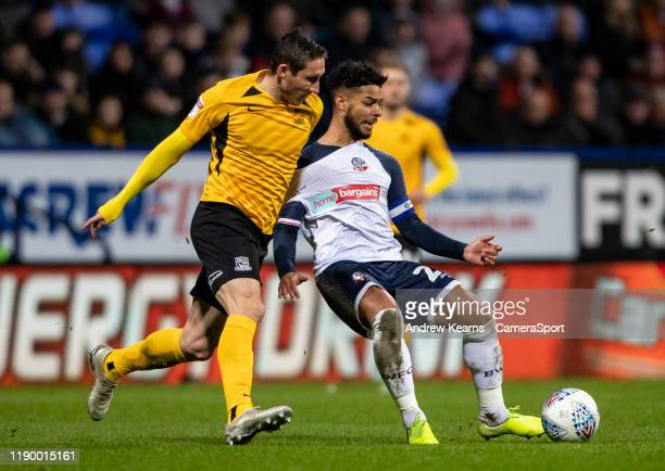 Bolton Wanderers' Liam Bridcutt competing with Southend United's Mark Milligan during the Sky Bet League One match between Bolton Wanderers and...