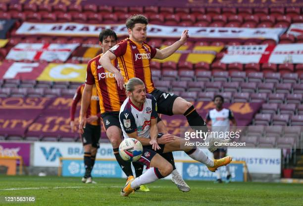 Bolton Wanderers' Lloyd Isgrove battles with Bradford City's Connor Wood during the Sky Bet League Two match between Bradford City and Bolton...