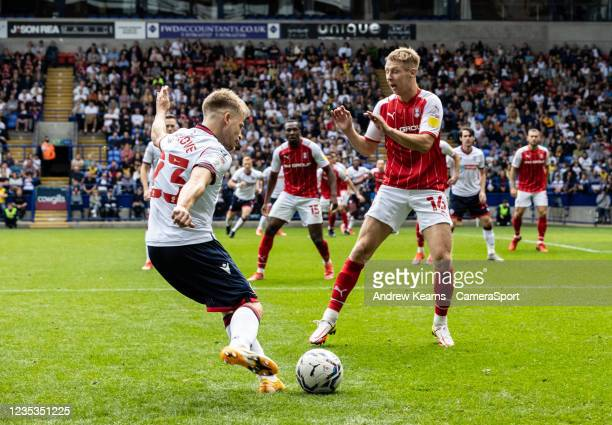 Bolton Wanderers' Lloyd Isgrove crosses under pressure from Rotherham United's Jamie Lindsay during the Sky Bet League One match between Bolton...