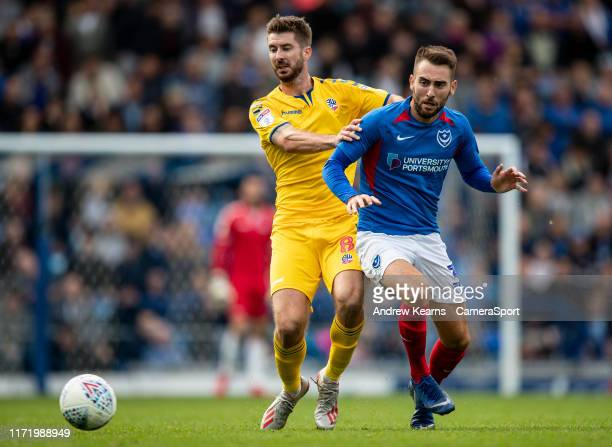 Bolton Wanderers' Luke Murphy competing with Portsmouth's Ben Close during the Sky Bet League One match between Portsmouth and Bolton Wanderers at...