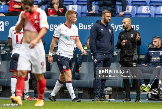 Bolton Wanderers' manager Ian Evatt chats to Rotherham United's manager Paul Warne during an injury breakduring the Sky Bet League One match between...