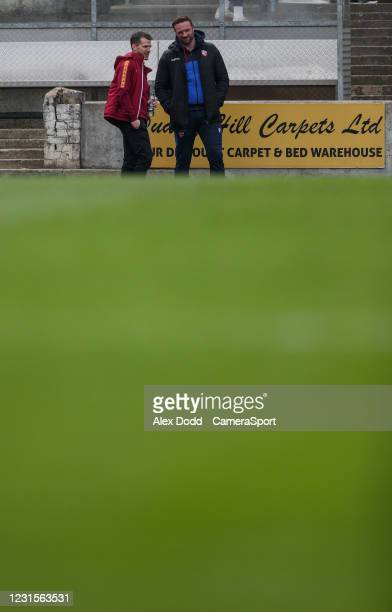 Bolton Wanderers manager Ian Evatt has a joke with a friend during the Sky Bet League Two match between Bradford City and Bolton Wanderers at...